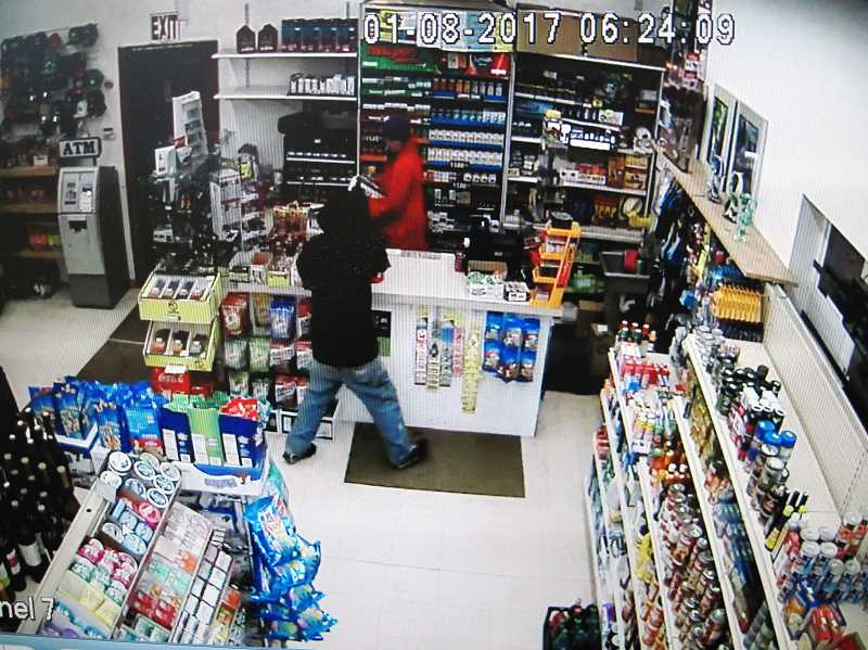 CONTRIBUTED PHOTO - Security camera footage from Big Jim's Corner Market shows an armed robbery on Saturday, Jan. 7. The suspect is described as a while male in his 30s and approximately 5 feet, 6 inches tall.