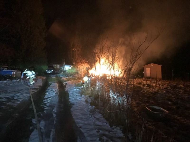 PHOTO COURTESY OF LT. JERRY COLE  - A fully involved trailer fire in Rainier on Monday, Jan. 9. The fire resulted in the death of one person.