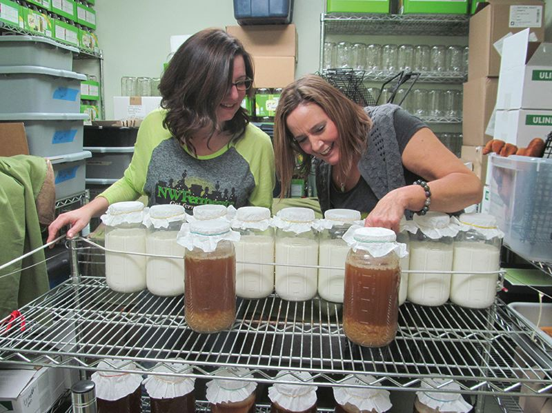 PHOTO BY ELLEN SPITALERI - Wendy Jensen, left, and Sue DePaolo, co-owners of NW Ferments, check out starters for several products at their site in Red Soils in Oregon City.
