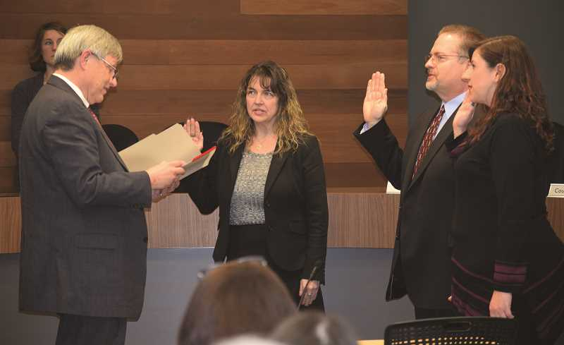 DANIEL PEARSON - Municipal Court Judge Rodney Grafe (left) swears in Canby City Councilors (from left) Traci Hensley, Tim Dale and Sarah Spoon. Each councilor begins serving a four-year term that ends Dec. 31, 2020.