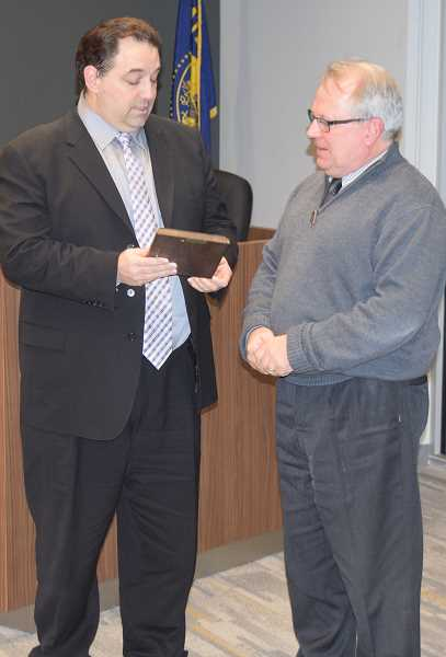 DANIEL PEARSON - Mayor Brian Hodson (left) presents outgoing city councilor Clint Coleman with a plaque commemorating his years of service on the council.
