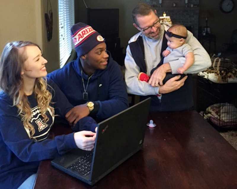 SUBMITTED PHOTO - Forest Grove Police Capt. Mike Herb (holding granddaughter Khalaya) says his relationship with her father, Khaylub, has led to deep conversations about racial bias and helped both of them better understand each others experience.