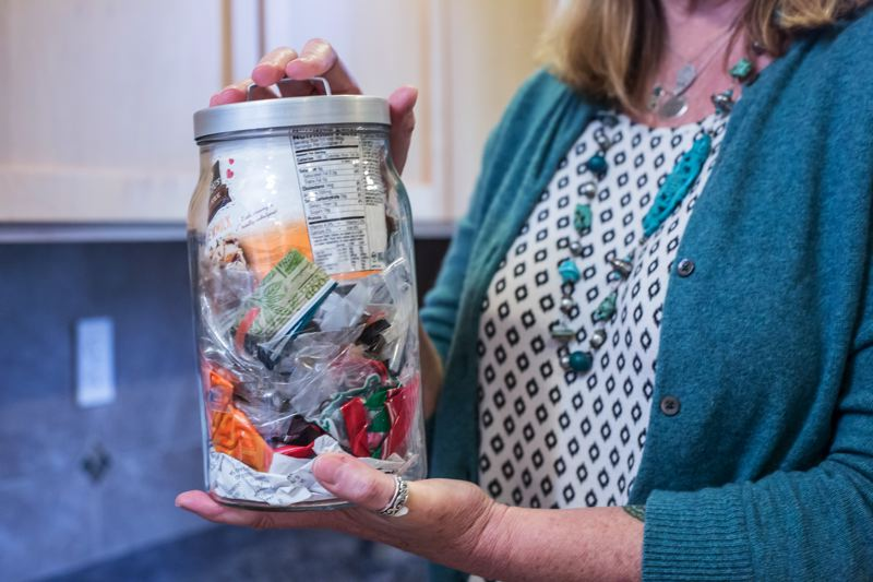PAMPLIN MEDIA GROUP: JONATHAN HOUSE - Kathy Peterman holds a jar of waste that, along with one other jar, contains ALL of her trash that went into the landfill for all of last year.