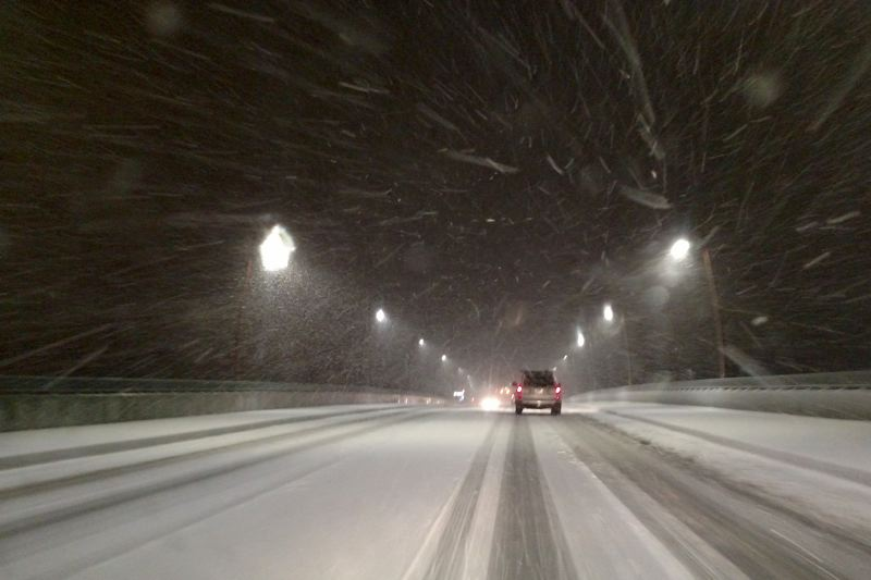 TRIBUNE PHOTO: JONATHAN HOUSE - Snow blown by a howling east wind whipped across the Sellwood Bridge Tuesday evening.