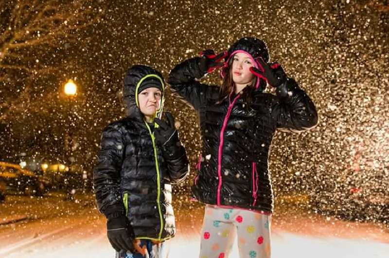 COURTESY OF JENNIFER HARRIS - Two young people pose in the rapidly falling snow in Sherwood on Tuesday evening.