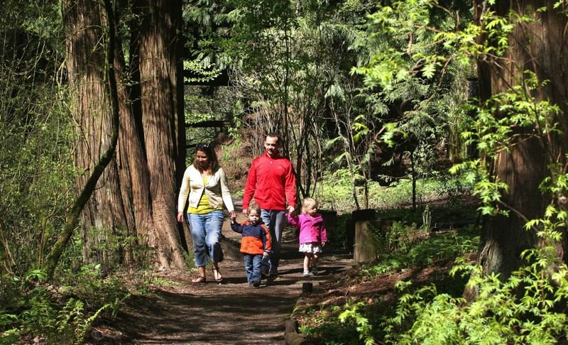 PAMPLIN MEDIA GROUP FILE PHOTO - Viri and Danny Arguello babysit Graham and Phoebe, taking them for a walk in Leach Botanical Garden in 2014.