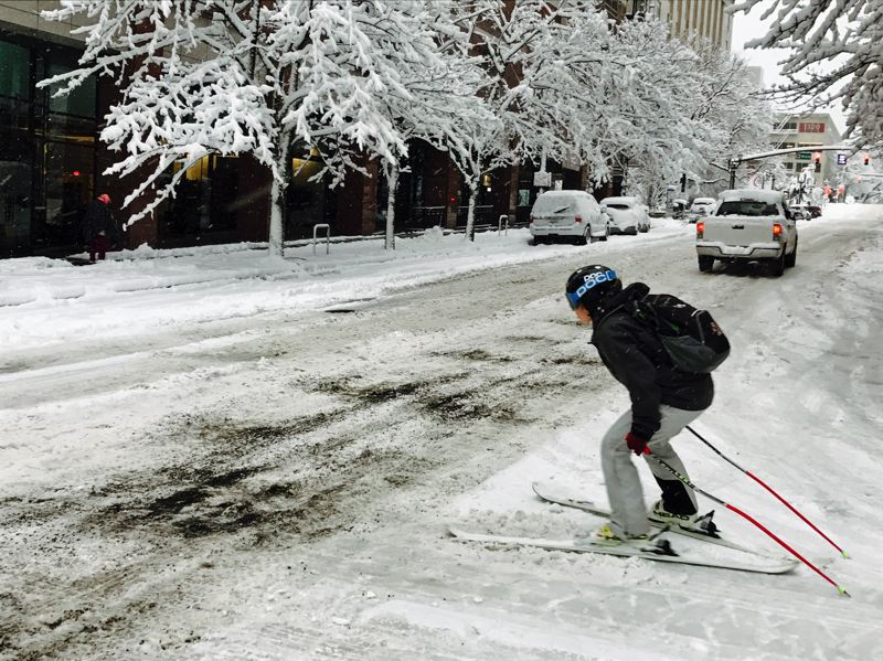 TRIBUNE PHOTO: DANA HAYNES - One commuter braves the otherwise-impassable streets of downtown Portland early Wednesday morning.