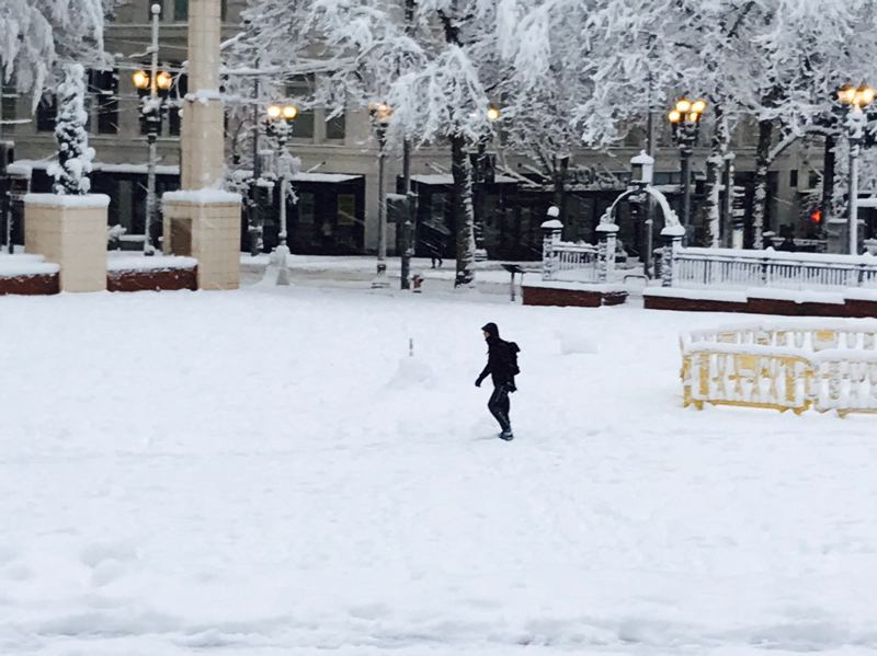 TRIBUNE PHOTO: DANA HAYNES - A lone commuter trudges across Pioneer Courthouse Square early Wednesday morning.