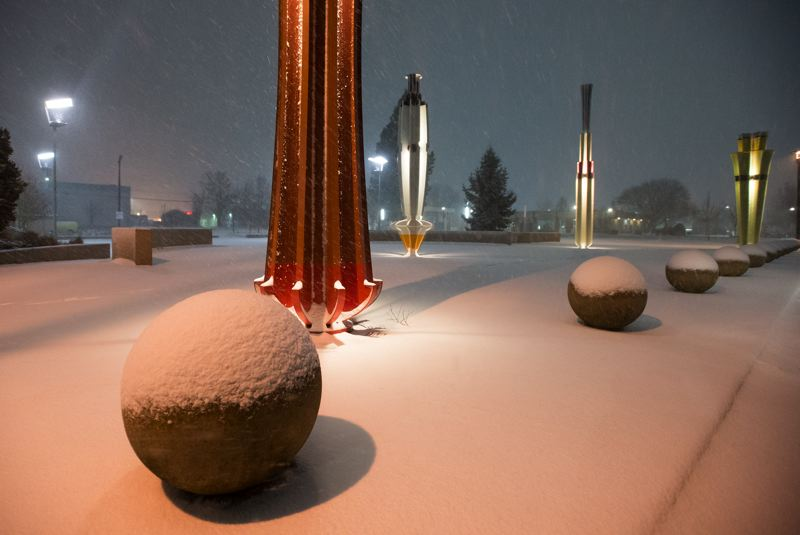 OUTLOOK PHOTO: JOSH KULLA - Snow blankets Gresham's Center for the Arts Plaza Tuesday night as the latest snowstorm to pummel the region settles in.