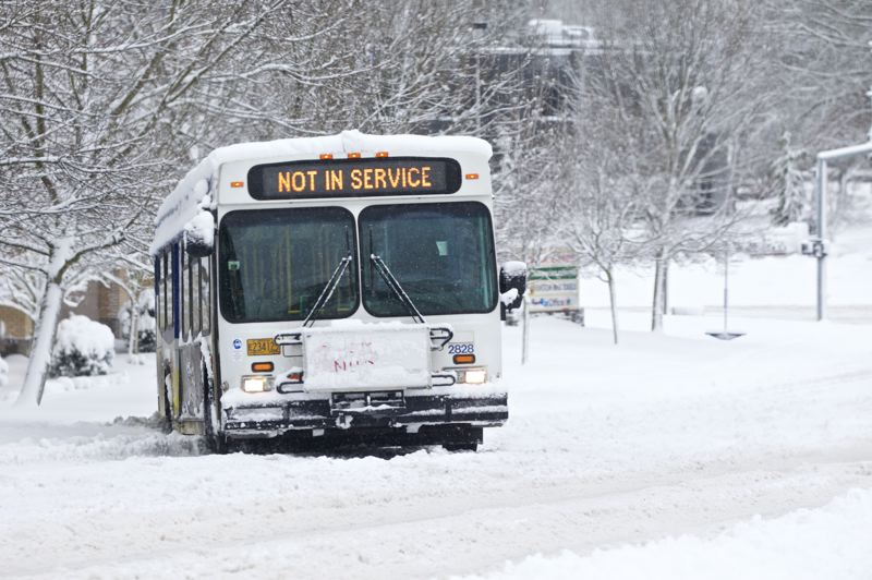 TIMES PHOTO: JAIME VALDEZ - A TriMet bus sits stuck along Hall Boulevard in Beaverton on Wednesday.