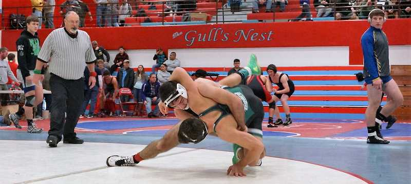 PHOTO CREDIT: BG AGUIRRE - Lions senior Zach Gadbois faced Tigard senior Parker Kuntz in the Pacific Rim Armed Forces Tournament's 160-pound championship in Seaside but Kuntz took the title 9-6.