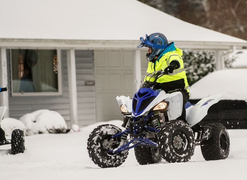 OUTLOOK PHOTO: JOSH KULLA - A southeast Gresham resident gets around his neighborhood in fine form this morning following nearly a foot of snow.