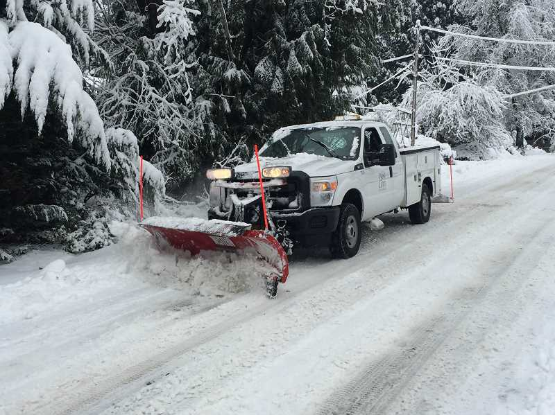 TIDINGS PHOTO: ANDREW KILSTROM - West Linn Parks and Recreation has spent the day plowing major streets around the city, like Cedaroak Drive pictured here.