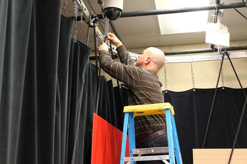 TIDINGS PHOTO: ANDREW KILSTROM - Troy Stoeber makes some alterations to the set before filming starts.