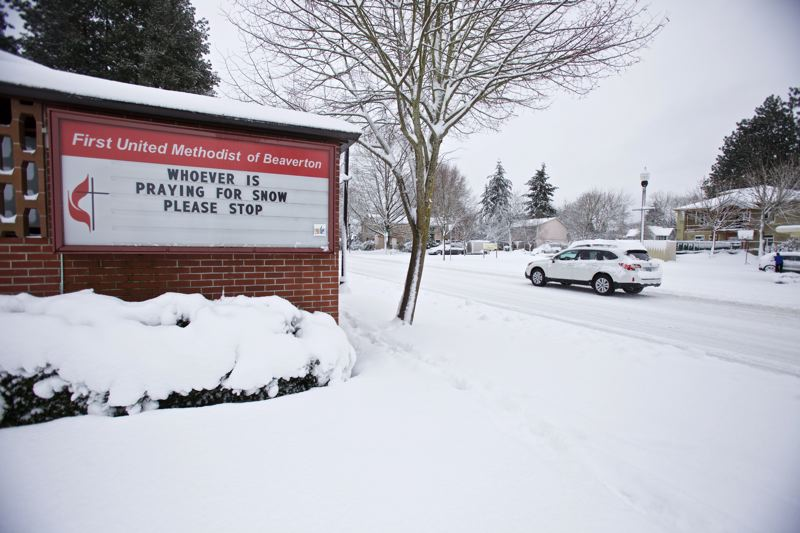 TRIBUNE PHOTO: JAIME VALDEZ - A church readerboad in Beaverton takes a whimsical approach to the storm.
