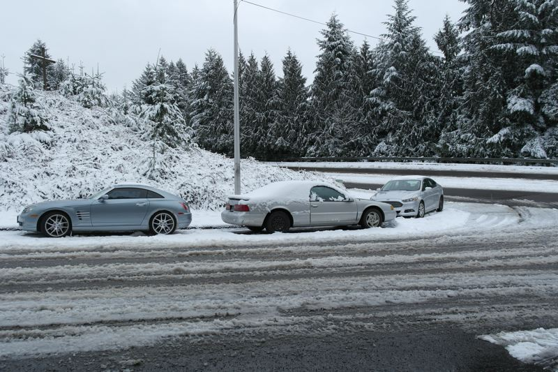 SPOKESMAN PHOTO: CLAIRE GREEN - Vehicles around Wilsonville without chains lost traction on hills and corners, getting stranded after spinning and sliding.