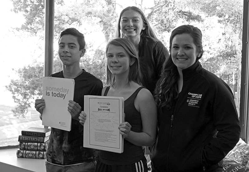 REVIEW PHOTO: JILLIAN DALEY - Lakeridge students Lily Barna (back row) and Seba Marin Quiros (center) are candidates for the Student of the Year competition through the Leukemia and Lymphoma Societys local chapter. Barna and Marin-Quiros are getting help from fellow students, including Eva Augst, and receiving guidance from LLS campaign specialist Lisa Little.