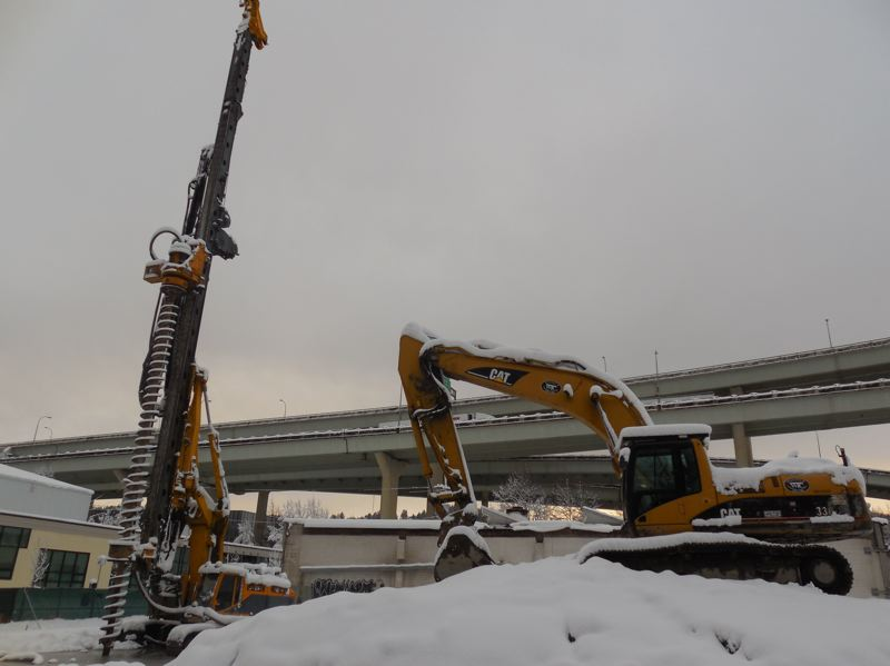 PAMPLIN MEDIA GROUP: JOSEPH GALLIVAN - A snow-covered drill bit sits unused as piling work was delayed by lack of cementat Alliance's site at 1411 N.W. Quimby Street Wednesday.