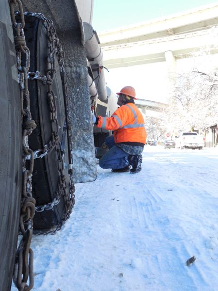 PAMPLIN MEDIA GROUP: JOSEPH GALLIVAN - Greg of Gresham Transfer delivers dry cement to Alliances site at 1411 N.W. Quimby Street last Thursday. Roads were made impassable by snow the day before, although other workers made it in, they couldnt do anything without the delivery.