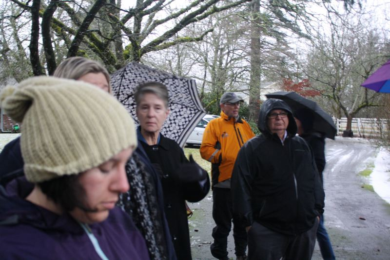 OUTLOOK PHOTO - Metro Councilor Shirley Craddick (center, with umbrella) is a proponent of the new trail system.