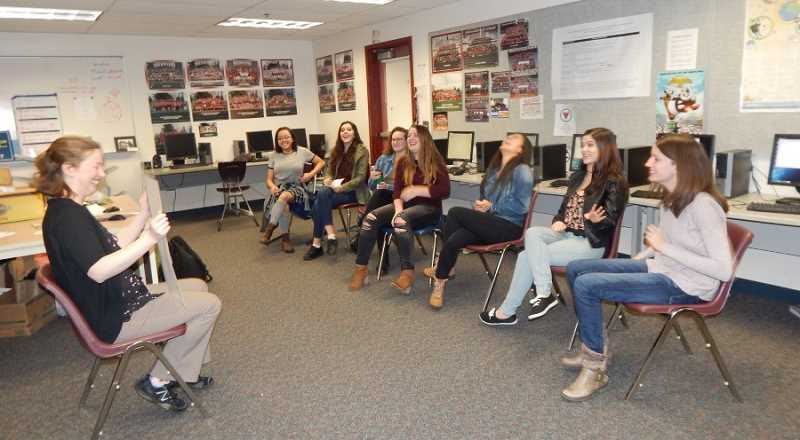 BARBARA SHERMAN - Caitlin Toohey (left), who is mentoring Sherwood High School's Girls Who Code group, leads an exercise in the computer lab with (from left) junior Carrie Nguyen, junior Brooke Mylander, senior Sophia Antrim, junior Alese Semingson, junior Brenna Cosio, junior Kianna O'Sullivan and junior Elaine Meslow.