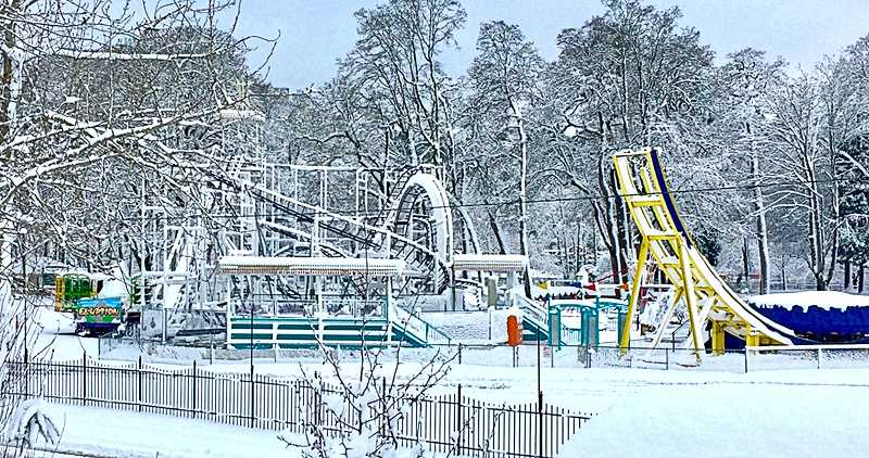 DAN O'FLAHERTY - Covered by snow, the rides at Oaks Amusement Park await the arrival of spring.
