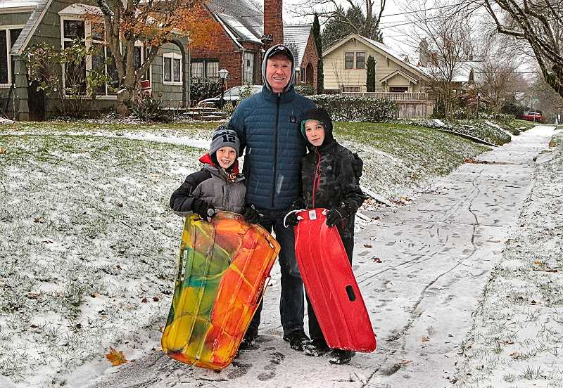 DAVID F. ASHTON - During the first winter storm, before the snow turned to ice, many families took advantage of the day off for some outdoor fun - among them, the Pinaire family: Wills, Brian, and Lucas.