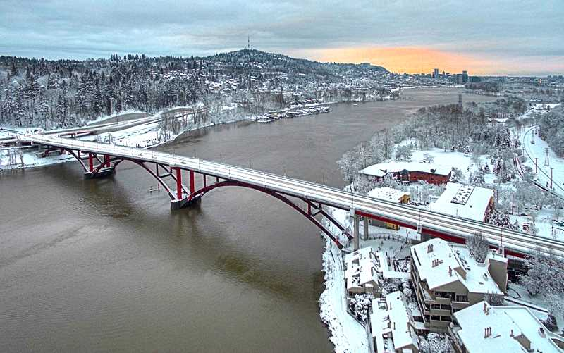 ALVARO FONTAN - This view of the new Sellwood Bridge from an airborne photo drone, looking north towards downtown right at sunset, on the snowy afternoon of January 11, was taken by Alvaro Fontan of Pamplin Media.