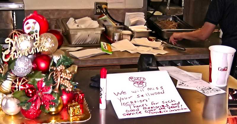 ERIC NORBERG - A few customers even left personal notes for the staff on the counter, as Mikes prepared to close forever in Sellwood on December 17.