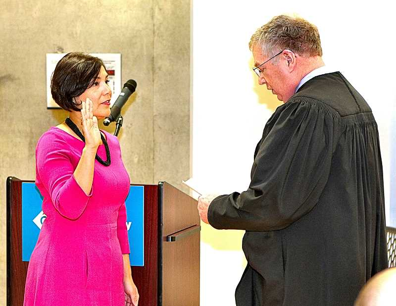 DAVID F. ASHTON - New District 3 County Commissioner Jessica Vega Pederson is sworn in by Multnomah County Judge John A. Wittmayer.