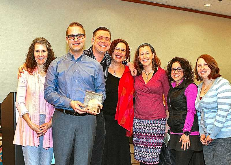 DAVID F. ASHTON - Commissioner Amanda Fritz presents the 2016 Neighborhood of the Year Spirit of Portland Award to Foster-Powell Neighborhood Association Chair Brian Balla, Past Chairs Christian Smith and Erika Bjerning, and Board Members Ellie Russell, Natalia Barwegen, and Rebecca Lavelle-Register.
