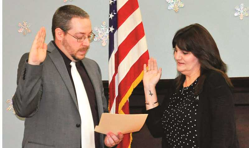 CITY OF MOLALLA - Thompson administers oath of office to new Molalla city councilor, Cindy Dragowsky.