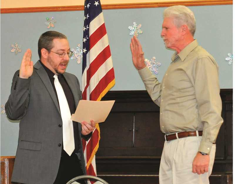CITY OF MOLALLA - Keith Swigart takes the oath of office as one of three new Molalla city councilors.