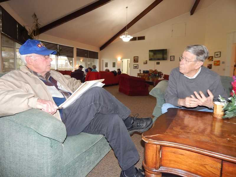 BARBARA SHERMAN - Sitting in the King City Clubhouse living room, King City Lions Bill Gerkin (left) and Ron Baker discuss the organization's many charitable endeavers over the past 50 years.