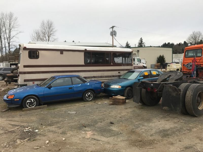 PHOTO COURTESY: CITY OF GLADSTONE - Gladstone City Administrator Eric Swanson called the 18505 Portland Ave. property an eyesore, including broken-down cars and used tires that will attract mosquitoes if allowed to remain until summer.