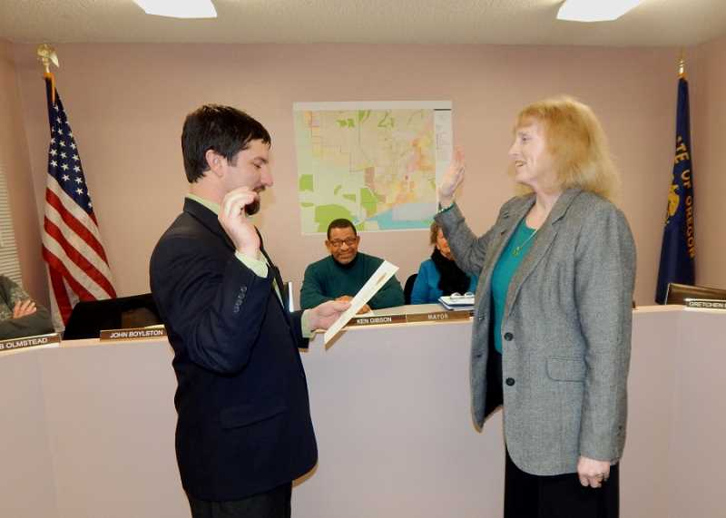 BARBARA SHERMAN - Gretchen Buehner recites the oath of office to King City City Manager Mike Weston before taking her seat on the dias.
