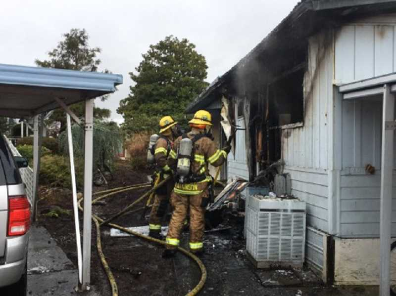 COURTESY OF TUALATIN VALLEY FIRE & RESCUE - A crew from Tualatin Valley Fire & Rescue Station 35 in King City knocks down a fire at Royal Villas that destroyed the home.