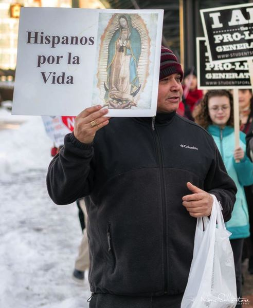 """MARK SALVATORE OF OREGON RIGHT TO LIFE - A man carries a sign that says """"Hispanics for life"""" in Spanish at the Portland Walk for Life Jan. 15, 2017, at the Oregon Convention Center."""
