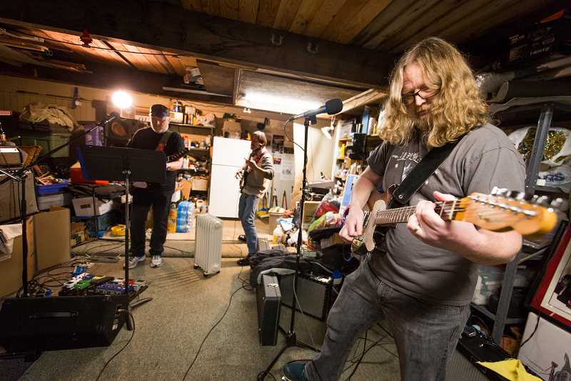PAMPLIN MEDIA GROUP: ADAM WICKHAM - Matt Bell plays guitar at a Raindriver practice session.