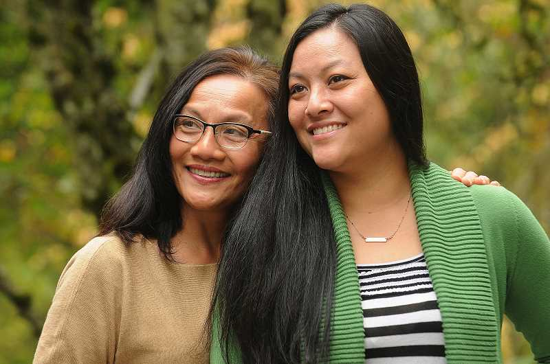 REVIEW PHOTO: VERN UYETAKE - Thu Nguyen (left) and her daughter, Lake Oswego resident Tam Hixson, spent time recently reminiscing about their family's escape from war-torn Vietnam in 1979. Hixson was born in an Indonesian refugee camp as the family made its way to the United States.
