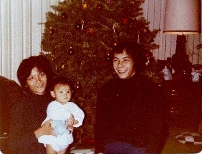PHOTO COURTESY OF TAM HIXSON - Thu Nguyen (Tam's mom, left) and Hoang Nguyen (her father) pose with their 8-month-old daughter in this photo taken shortly after the family arrived in Spokane in December 1979.