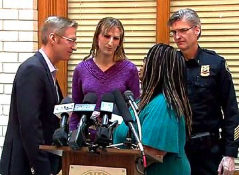 COURTESY PHOTO: KOIN 6 NEWS - Mayor Ted Wheeler and Police Chief Mike Marshman talk with organizers of Saturday's Women's March after a City Hall press conference Wednesday afternoon.
