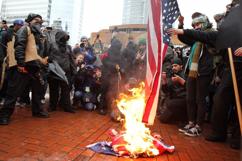 Protesters stoke anti-Trump flames at downtown rally
