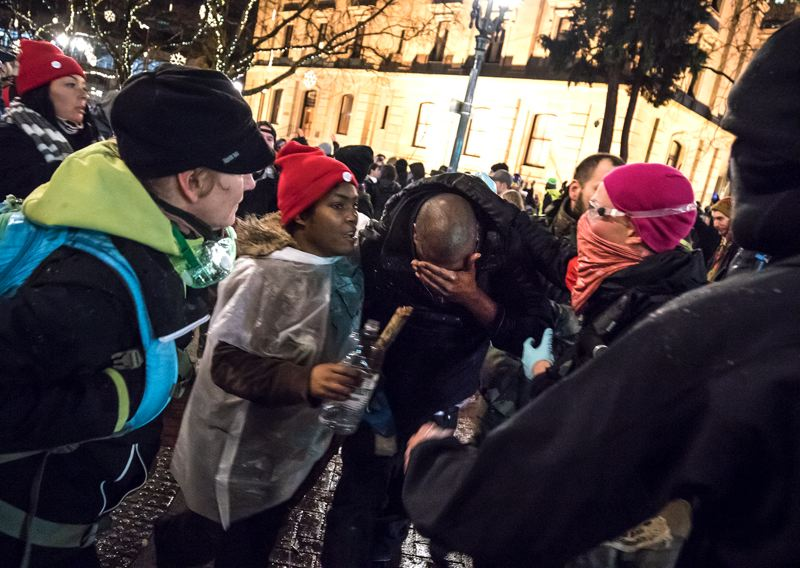 TRIBUNE PHOTO: JONATHAN HOUSE - Portland police used pepper spray on parts of the crowd that marched through downtown streets Friday night.