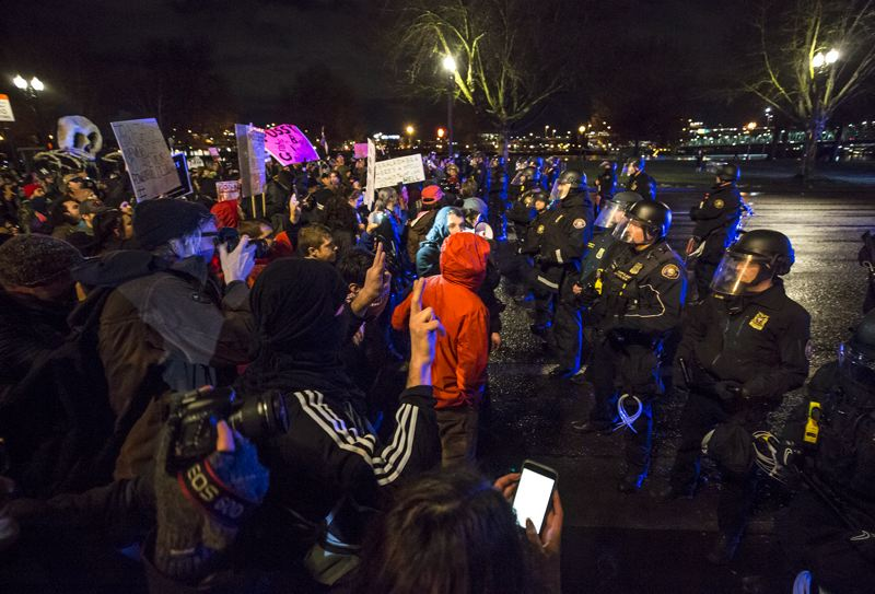 TRIBUNE PHOTO: JONATHAN HOUSE - Protesters who continued to march through the streets Friday night, hours after a peaceful rally and march, were prevented by police from blocking downtown traffic and bridges.