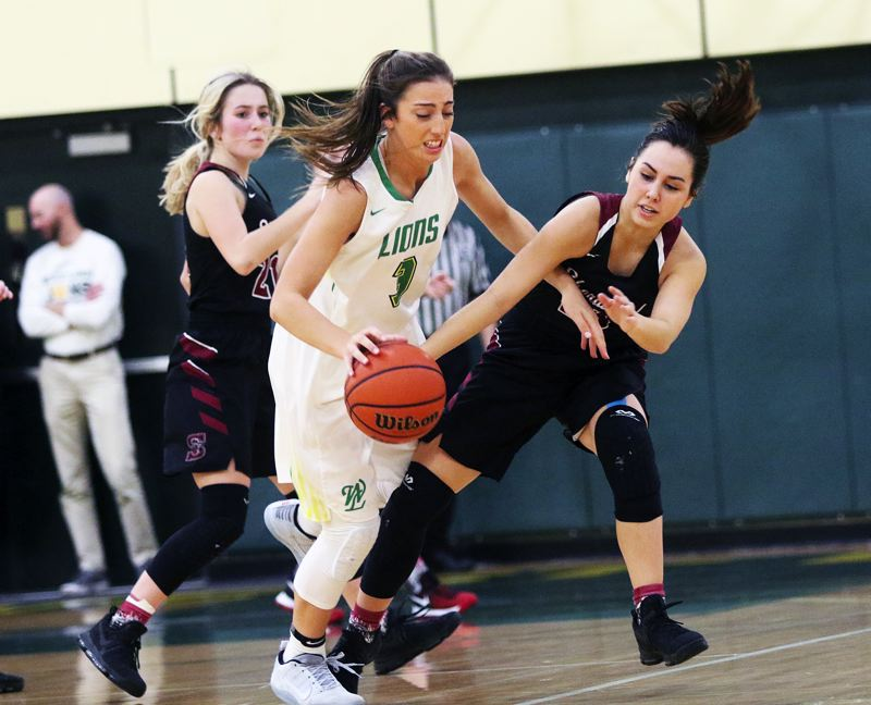 PMG PHOTO: DAN BROOD - Sherwood senior Cami Reuter (right) tries to knock the ball away from West Linn junior Lexi Pritchard.