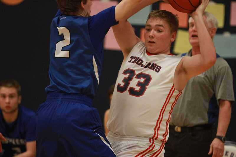Boys basketball: Trojans drop first conference game