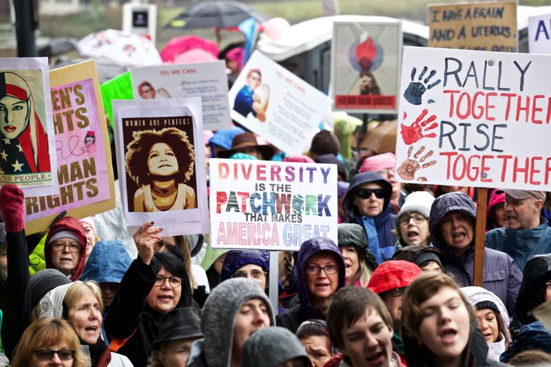 PAMPLIN MEDIA GROUP PHOTO: JAIME VALDEZ - Rain didn't dampen spirits of the thousands who jammed Waterfront Park Saturday for the Portland Women's March.