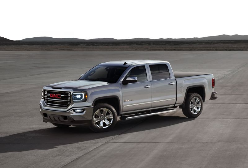 COURTESY: GMC - The GMC Sierra. Businesses rushed to upgrade their vans at the end of 2016 to take advantage of a tax break and a stong economy.