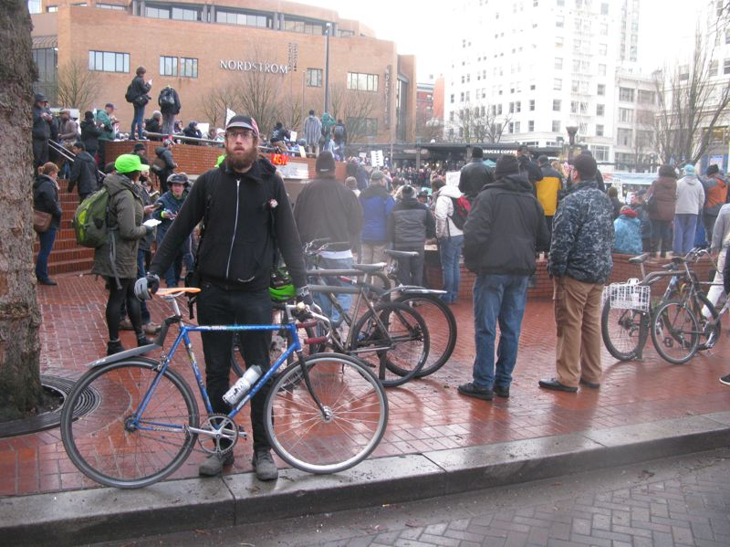 RAYMOND RENDLEMAN - Milwaukie resident Anthony Dryer, 35, joins the crowd packing Pioneer Courthouse Square on Friday.